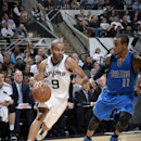SAN ANTONIO, TX - OCTOBER 28: Tony Parker #9 of the San Antonio Spurs handles the ball against the Dallas Mavericsk at the AT&T Center on October 28, 2014 in San Antonio, Texas