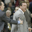 Kansas head coach Bill Self center, reacts after he is called for a technical foul during the first half of their basketball game against South Carolina Sunday, Jan. 7, 2007. at the Colonial Center in Columbia, S.C. Restraining him is assistant coach Joe Dooley, left.(AP Photo/Mary Ann Chastain)