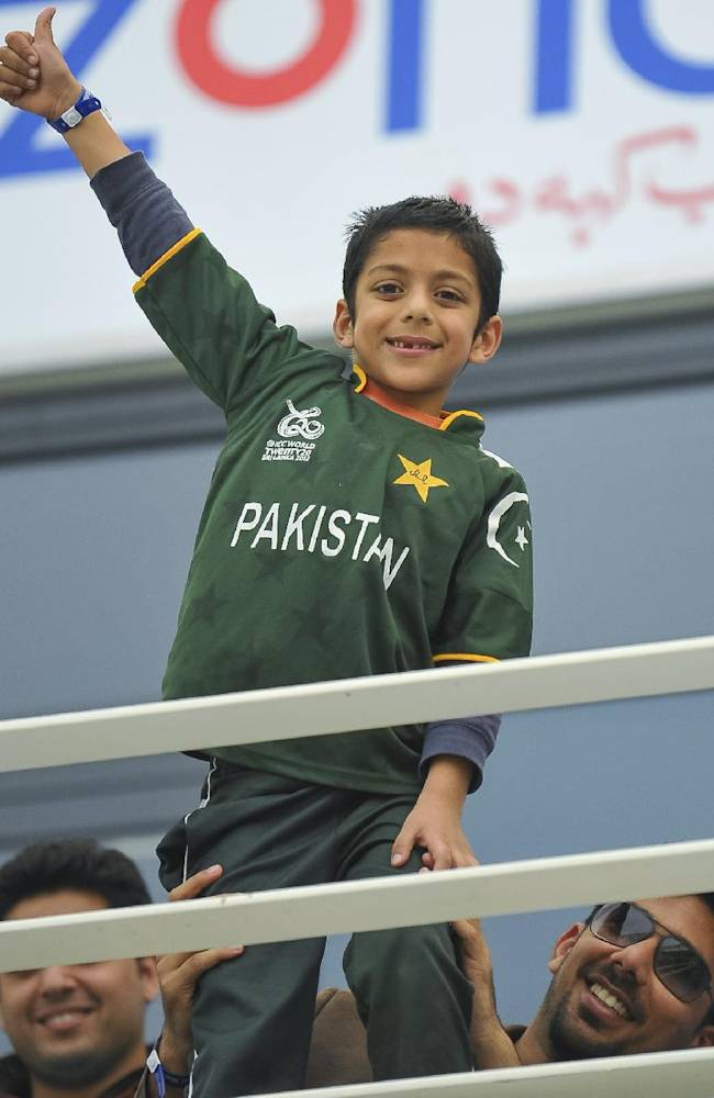 A young Pakistan fan cheers during the second cricket test match between Pakistan and Sri Lanka at the Dubai International Cricket Stadium in Dubai, United Arab Emirates, Friday, Jan. 10, 2014