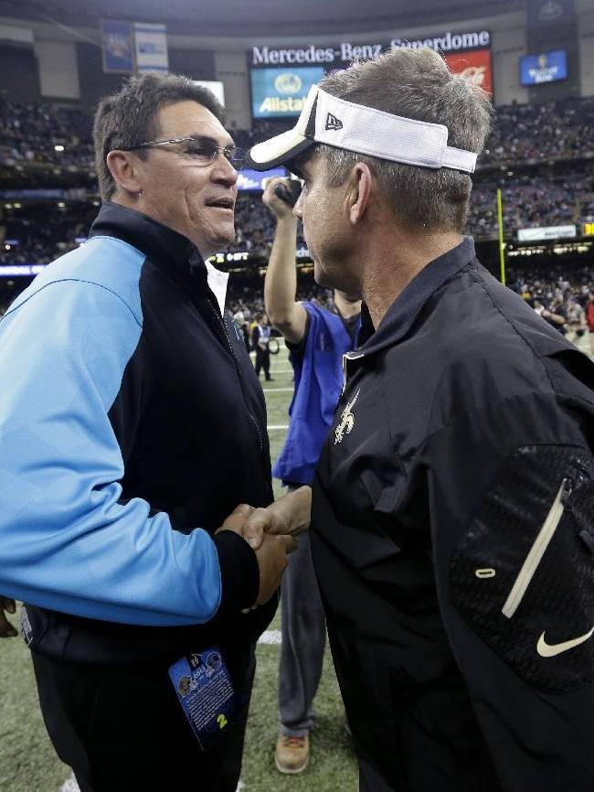 Carolina Panthers head coach Ron Rivera, left, shakes hands with New Orleans Saints head coach Sean Payton after an NFL football game in New Orleans, Sunday, Dec. 8, 2013. The Saints won 31-13