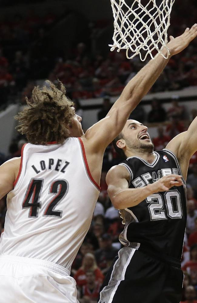 San Antonio Spurs' Manu Ginobili (20) lays the ball up as Portland Trail Blazers' Robin Lopez (42) defends in the fourth quarter during Game 3 of a Western Conference semifinal NBA basketball playoff series Saturday, May 10, 2014, in Portland, Ore. The Spurs won 118-103