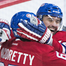 Montreal Canadiens' Tomas Plekanec, right, celebrates with teammate Max Pacioretty after scoring against the New York Rangers during the first period of an NHL hockey game Saturday, Oct. 25, 2014, in Montreal The Associated Press