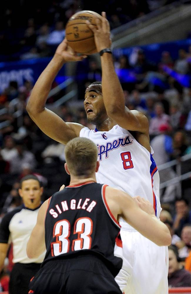 Los Angeles Clippers forward Brandon Davies (8) battles Portland Trail Blazers forward E.J. Singler (33) as he looks for the open man in the second half of a pre-season NBA basketball game, Friday, Oct. 18, 2013, in Los Angeles. The Trail Blazers won 94-84