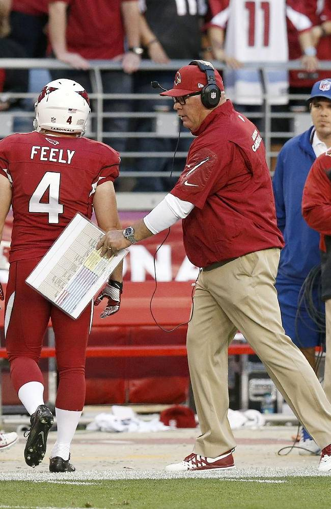 Arizona Cardinals head coach Bruce Arians, right, consoles Jay Feely (4) after a missed field goal against the San Francisco 49ers during the second half of an NFL football game Sunday, Dec. 29, 2013, in Glendale, Ariz. The 49ers won 23-20