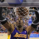 Los Angeles Lakers center Dwight Howard dunks during the first half of their NBA basketball game against the Los Angeles Clip