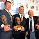James Bates, Ben Zambiasi and Pat Dye, from left, pose with their busts after the induction ceremony at the Georgia-Florida Hall of Fame on Friday, Oct. 31, 2014, in Jacksonville, Fla. Louis Oliver was unable to attend. Dye and Zambiasi, from the Universi