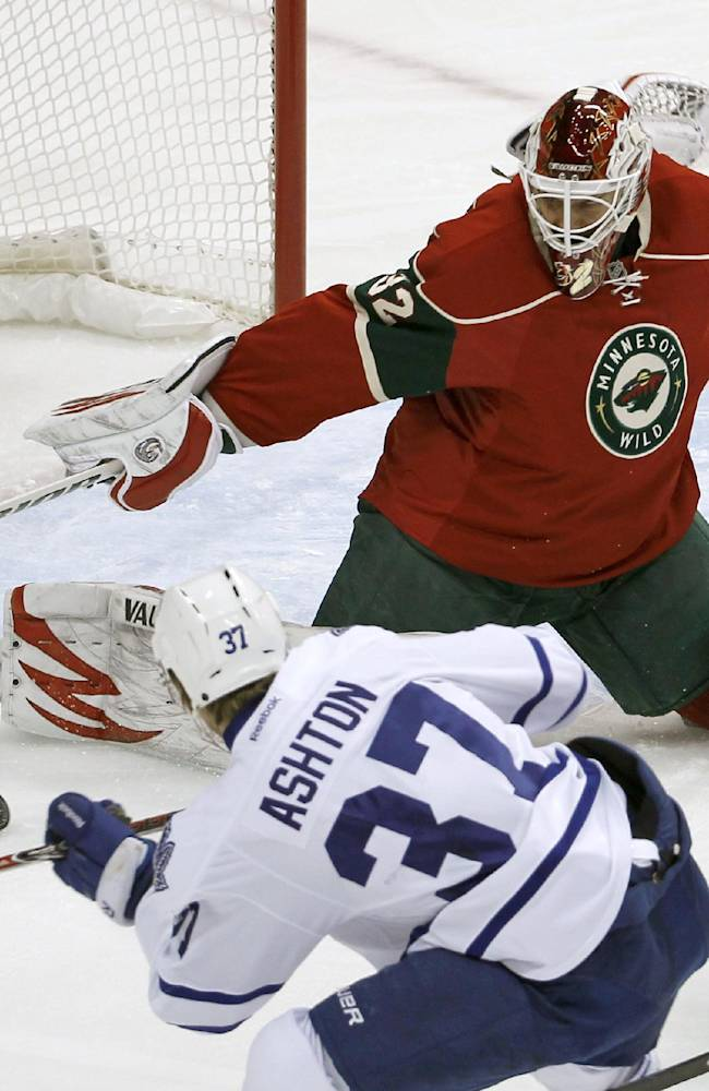 Minnesota Wild goalie Niklas Backstrom (32), of Finland, stops a shot by Toronto Maple Leafs right wing Carter Ashton (37) during the first period of an NHL hockey game in St. Paul, Minn., Wednesday, Nov. 13, 2013