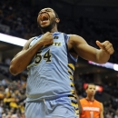 Marquette's Davante Gardner (54) celebrates a basket against Syracuse during the first half of an NCAA college basketball game, Monday, Feb. 25, 2013, in Milwaukee. (AP Photo/Jim Prisching)