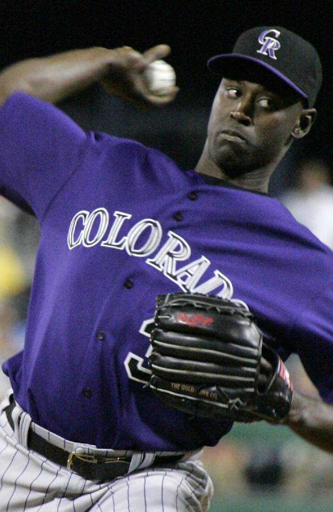 This July 16, 2007 file photo shows Colorado Rockies relief pitcher LaTroy Hawkins throwing against the Pittsburgh Pirates during a baseball game in Pittsburgh. Hawkins is returning to the Rockies and the veteran reliever may just possibly wind up as their closer. Hawkins agreed to a one-year, $2.5 million deal on Tuesday, Nov. 19, 2013, a person familiar with the negotiations told The Associated Press