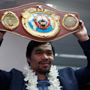 Filipino boxer and Senator Manny Pacquiao raises his boxing winning belt during a news conference upon arrival, after winning WBO welterweight bout with Jessie Vargas, at Ninoy Aquino International airport in Paranaque, Metro Manila in the Philippines, November 8, 2016.  REUTERS/Erik De Castro