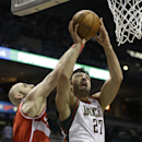 Milwaukee Bucks' Zaza Pachulia (27) shoots against Washington Wizards' Marcin Gortat during the first half of an NBA basketball game on Saturday, March 8, 2014, in Milwaukee The Associated Press