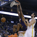 Phoenix Suns' Channing Frye (8) scores past Golden State Warriors' Andrew Bogut, right, during the first half of an NBA basketball game Sunday, March 9, 2014, in Oakland, Calif The Associated Press