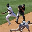 South Carolina's Tanner English (3) steals third base as Vanderbilt's Xavier Turner takes the high throw in the sixth inning of a Southeastern Conference tournament baseball college game at the Hoover Met in Hoover, Ala., Thursday, May 23, 2013. (AP Photo/Dave Martin)