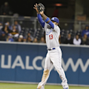 Los Angeles Dodgers shortstop Hanley Ramirez catches a line drive hit by San Diego Padres' Will Venable during the ninth inning of the Dodgers' 5-1 victory in a baseball game Wednesday, April 2, 2014, in San Diego The Associated Press