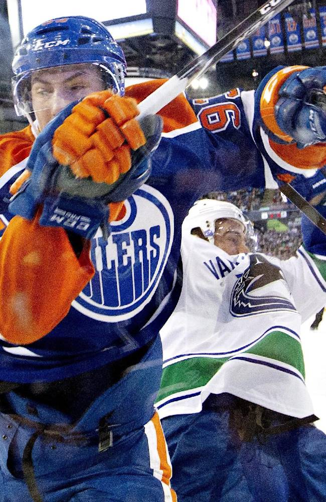 Without Tortorella, Canucks slip past Oilers 2-1