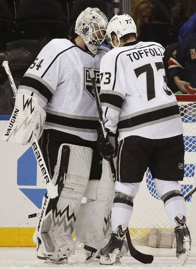Los Angeles Kings center Tyler Toffoli (73) celebrates with Kings goalie Ben Scrivens (54) after the Kings shutout the New York Rangers in their NHL hockey game at Madison Square Garden in New York, Sunday, Nov. 17, 2013. Toffoli scored the Kings only goal in the second period