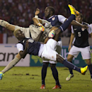 United States' Eddie Johnson, front, collides with Costa Rica's goalkeeper Keylor Navas who blocked his attempt to score during a 2014 World Cup qualifier soccer match in San Jose, Costa Rica, Friday, Sept. 6, 2013. Behind at center is U.S.' Jozy Altidore. (AP Photo/Moises Castillo)