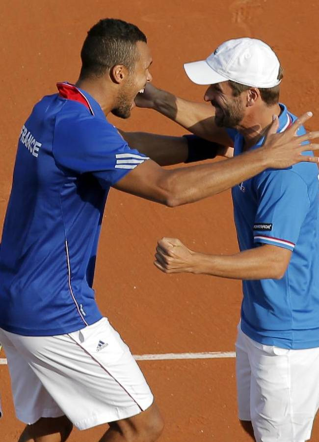 France's Jo-Wilfried Tsonga, left, and coach Arnaud Clement celebrate defeating the Czech Republic and winning the semifinal of the Davis Cup at the Roland Garros stadium, in Paris, Saturday, Sept. 13, 2014