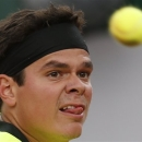 Canada's Milos Raonic eyes the ball as he returns against Michael Llodra of France in their second round match of the French Open tennis tournament, at Roland Garros stadium in Paris, Wednesday, May 29, 2013. (AP Photo/Petr David Josek)
