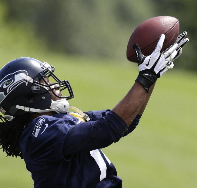 Seattle Seahawks' Arceto Clark catches the ball during NFL football rookie minicamp Saturday, May 17, 2014, in Renton, Wash