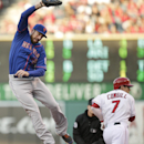 Los Angeles Angels' Collin Cowgill, right, takes first base as New York Mets first baseman Ike Davis, left, jumps to catch the throw during the first inning of a baseball game on Saturday, April 12, 2014, in Anaheim, Calif The Associated Press