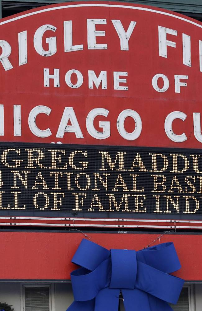 A sign at Wrigley Field in Chicago notes the election of former Chicago Cubs pitcher Greg Maddux to baseball's Hall of Fame on Wednesday, Jan. 8, 2014. Maddux, Frank Thomas and Tom Glavine were elected to baseball's Hall of Fame on Wednesday