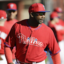 Philadelphia Phillies first baseman Ryan Howard warms up during spring training baseball practice on Sunday, Feb. 16, 2014, in Clearwater, Fla The Associated Press