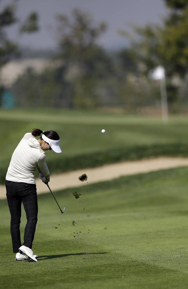 Grace Park of South Korea hits her approcah shot on the second hole during the first round of the LPGA KEB Hana Bank Championship golf tournament at Sky72 Golf Club in Incheon, west of Seoul, South Korea, Friday, Oct. 18, 2013