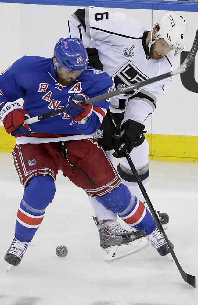 New York Rangers center Brad Richards (19) vies for the puck against Los Angeles Kings defenseman Jake Muzzin (6) in the first period during Game 4 of the NHL hockey Stanley Cup Final, Wednesday, June 11, 2014, in New York
