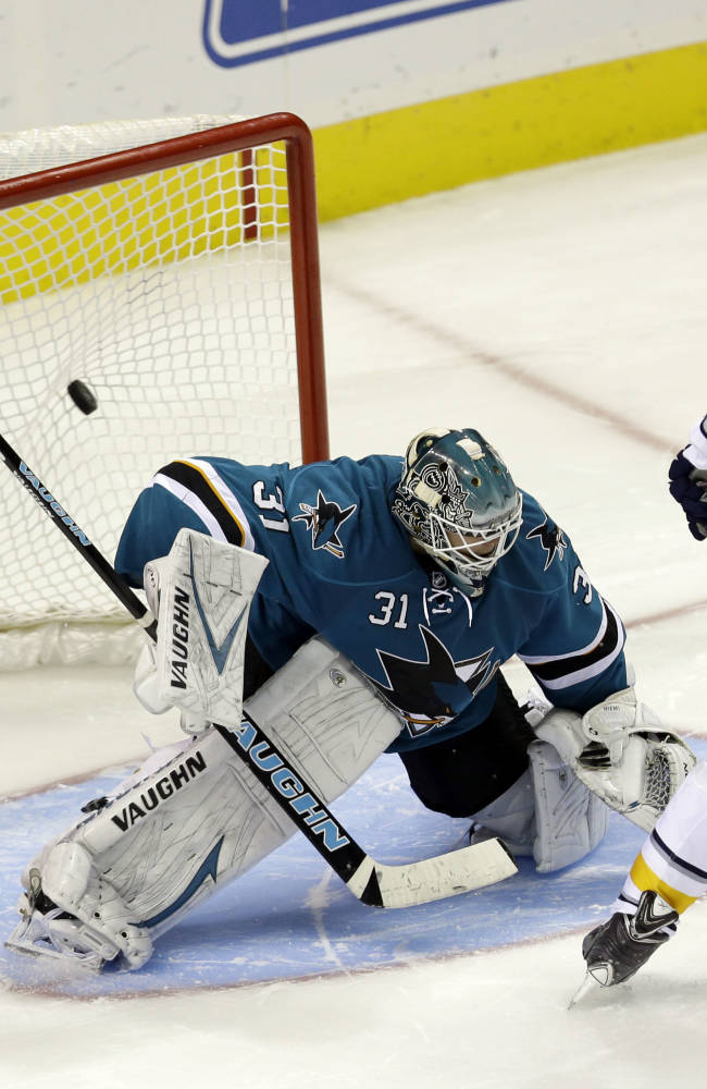 Buffalo Sabres' Cody Hodgson (19) scores the game-winning goal past San Jose Sharks' Antti Niemi, of Finland, during the shootout of an NHL hockey game on Tuesday, Nov. 5, 2013, in San Jose, Calif. Buffalo won 5-4