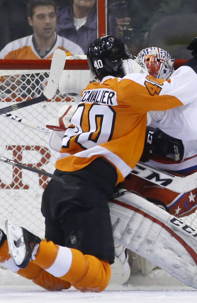 Philadelphia Flyers' Vincent Lecavalier, left, collides with Washington Capitals' Braden Holtby during the first period of an NHL hockey game, Wednesday, March 5, 2014, in Philadelphia