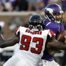 Minnesota Vikings quarterback Christian Ponder, right, tries to break a tackle by Atlanta Falcons defensive end Malliciah Goodman during the second half of an NFL football game, Sunday, Sept. 28, 2014, in Minneapolis. The Vikings won 41-28. The Associated
