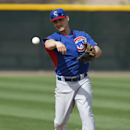 Chicago Cubs second baseman Darwin Barney fields grounders during spring training baseball practice, Wednesday, Feb. 19, 2014, in Mesa, Ariz The Associated Press