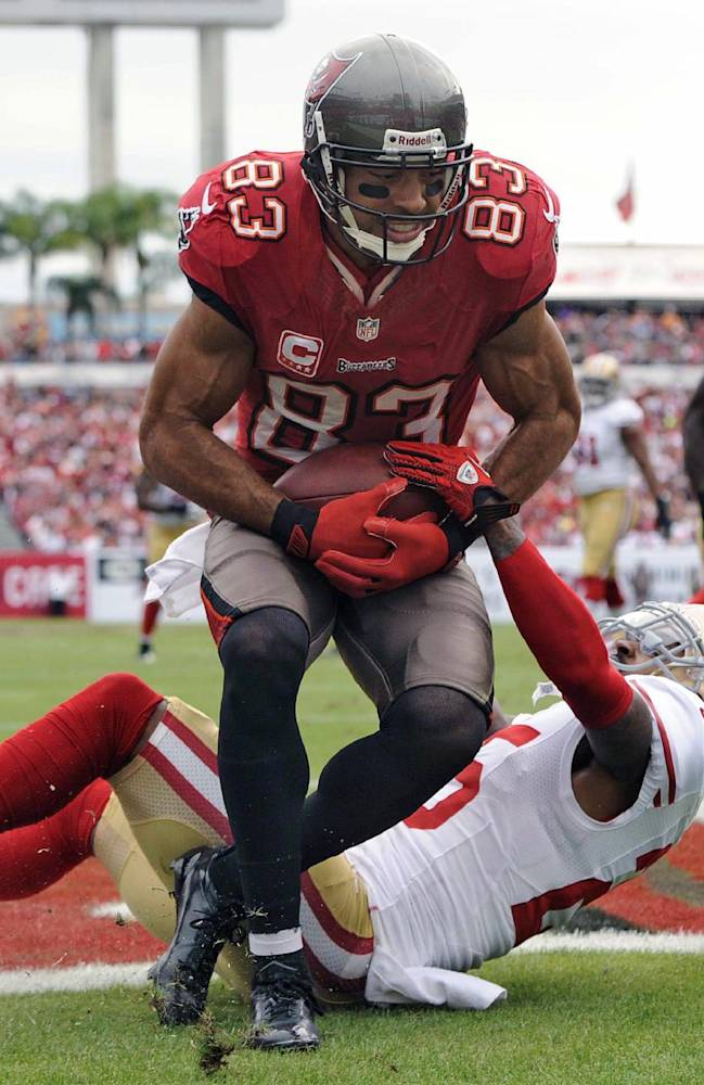 Tampa Bay Buccaneers wide receiver Vincent Jackson (83) is grabbed by San Francisco 49ers cornerback Tarell Brown (25) as he pulls in an 11-yard touchdown pass during the second quarter of an NFL football game, Sunday, Dec. 15, 2013, in Tampa, Fla