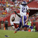 Minnesota Vikings cornerback Josh Robinson (21) loses a shoe while breaking up a pass intended for Kansas City Chiefs wide receiver Donnie Avery (17) during the first half of an NFL preseason football game in Kansas City, Mo., Saturday, Aug. 23, 2014 The