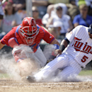 Philadelphia Phillies catcher Wil Nieves, left, tags out Minnesota Twins' Eduardo Escobar (5) on a fielder's choice in the seventh inning of a spring exhibition baseball game in Fort Myers, Fla., Sunday, March 9, 2014 The Associated Press