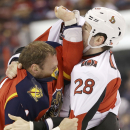 Florida Panthers right wing Krys Barch, left, and Ottawa Senators left wing Matt Kassian (28) fight during the first period of an NHL hockey game, Tuesday, March 25, 2014 in Sunrise, Fla The Associated Press