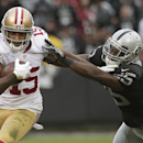 San Francisco 49ers wide receiver Michael Crabtree (15) stiff arms Oakland Raiders cornerback D.J. Hayden during the third quarter of an NFL football game in Oakland, Calif., Sunday, Dec. 7, 2014 The Associated Press
