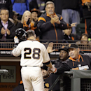 San Francisco Giants' Buster Posey is congratulated by manager Bruce Bochy, right, after Posey hit a home run off Arizona Diamondbacks' Bronson Arroyo in the fifth inning of a baseball game Wednesday, April 9, 2014, in San Francisco The Associated Press