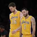Los Angeles Lakers' Pau Gasol, left, of Spain, and Jordan Farmar walk off the court during the first half of an NBA basketball game against the Los Angeles Clippers on Thursday, March 6, 2014, in Los Angeles The Associated Press