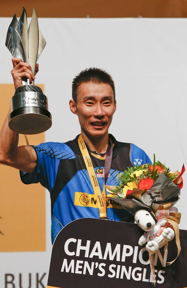 Malaysia's Lee Chong Wei poses with his trophy after winning the men's singles final match against Indonesia's Tommy Sugiarto at the Malaysia Open Badminton Super Series in Kuala Lumpur, Malaysia, Sunday, Jan. 19, 2014