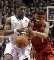 Purdue guard Ronnie Johnson, left, and Nebraska guard Deverell Biggs get tangled up in the first half of an NCAA college basketball game in West Lafayette, Ind., Sunday, Jan. 12, 2014. (AP Photo/Michael Conroy)