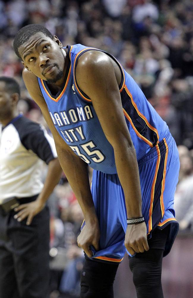 Oklahoma City Thunder forward Kevin Durant looks to the scoreboard in the final moments of the second half of an NBA basketball game against the Portland Trail Blazers in Portland, Ore., Wednesday, Dec. 4, 2013.  Portland beat Oklahoma City 111-104