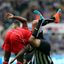 ALTERNATIVE CROP OF NSH111 - Newcastle United's Steven Taylor, right, vies for the ball with Liverpool's Mario Balotelli, left, during their English Premier League soccer match at St James' Park, Newcastle, England, Saturday, Nov. 1, 2014