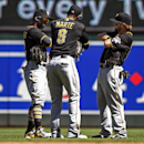Pittsburgh Pirates center fielder Andrew McCutchen, left, left fielder Starling Marte (6) and right fielder Jaff Decker, right, celebrate their 10-4 win over the Minnesota Twins in a baseball game Wednesday, July 29, 2015, in Minneapolis. (AP Photo/Bruce Kluckhohn)