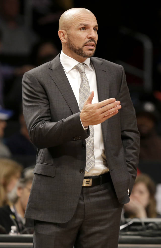 Brooklyn Nets coach Jason Kidd talks to a referee during the first half of an NBA basketball game against the Indiana Pacers on Monday, Dec. 23, 2013, in New York