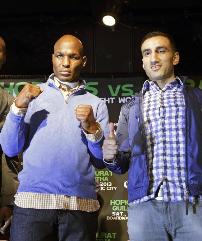 From left, boxers Peter Quillan, of New York, Bernard Hopkins, of Philadlephia, Karo Murat of Germany, and Gabriel Rosado, of Philadelphia, pose for photographers during a news conference Wednesday, Oct. 23, 2013, in New York. Hopkins will square off against Murat, and Quillan will square off against Rosada on Saturday in Atlantic City, N.J