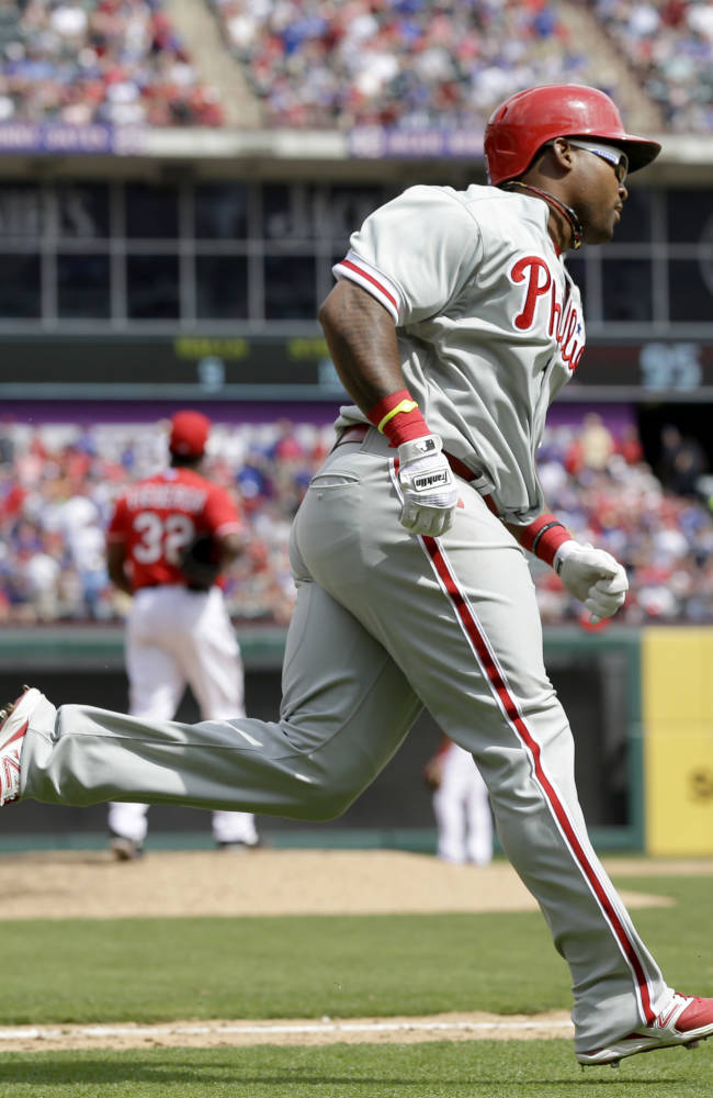 Phillies open with 14-10 victory at Rangers