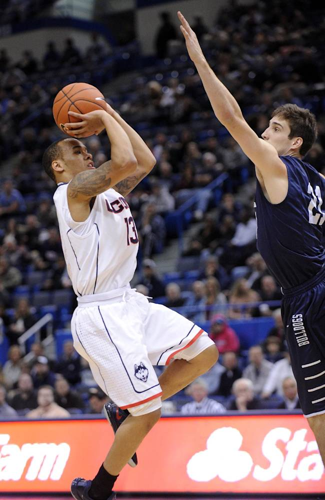 Connecticut's Shabazz Napier (13) shoots over Yale's Nick Victor (21) during the first half of an NCAA college basketball game, in  Hartford, Conn., on Monday, Nov. 11, 2013