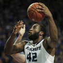Kansas State forward Thomas Gipson (42) gets past a Texas defender during the second half of an NCAA college basketball game in Manhattan, Kan., Wednesday, Jan. 30, 2013. Gipson scored 17 points in the game. Kansas State defeated Texas 83-57. (AP Photo/Orlin Wagner)